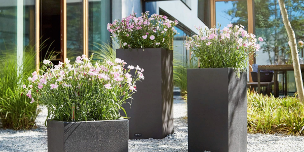 fake flowers in planters in the garden pathways